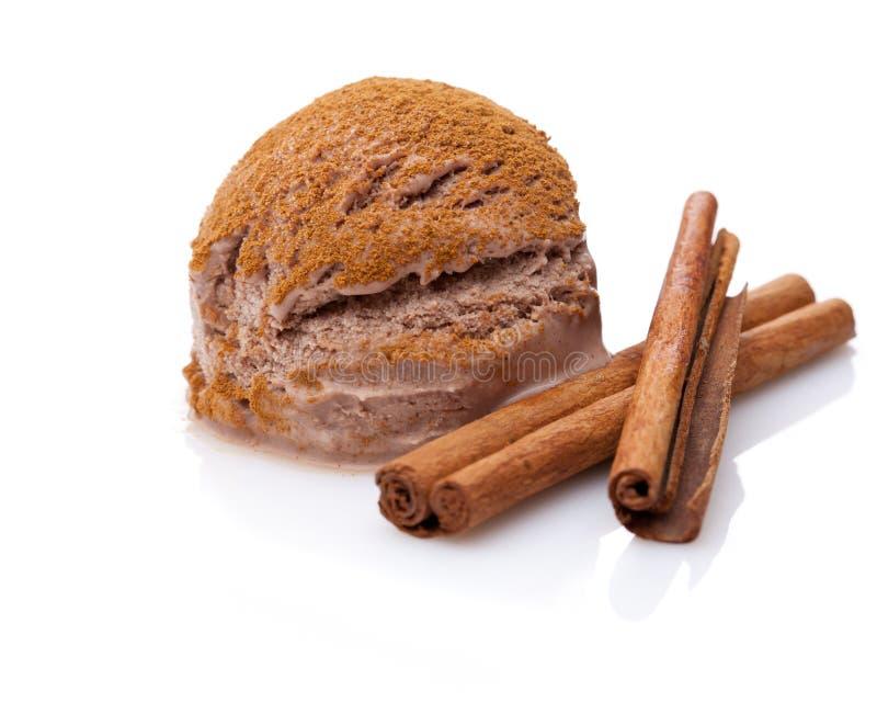 A scoop of cinnamon ice cream with cinnamon sticks stock images