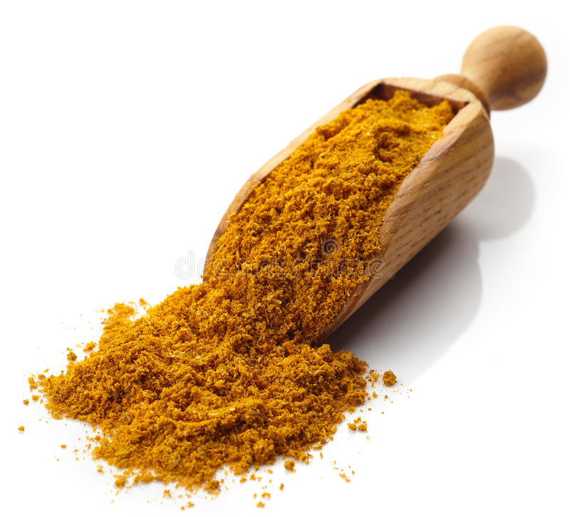 Scoop of curry powder stock photos