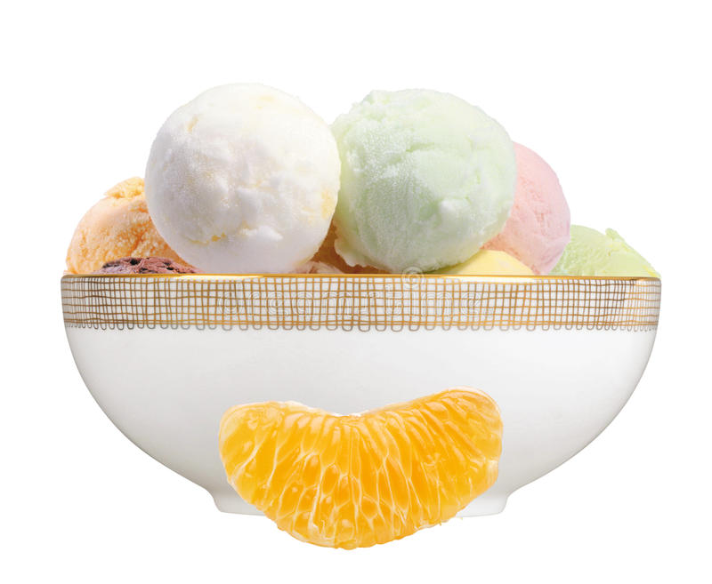Scoop of fruit ice cream and orange slice in plate isolated on w stock photo