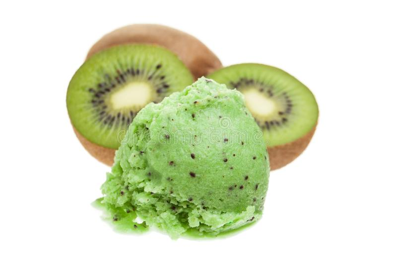 A scoop of kiwi ice cream with kiwis isolated on white background royalty free stock images