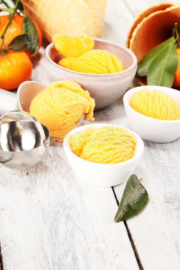 Scoop of tangarine orange ice cream. delicious icecream set stock photography