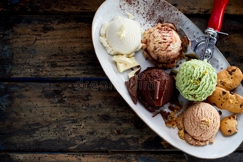 Scoops of Assorted Ice Cream Flavors on Platter royalty free stock image