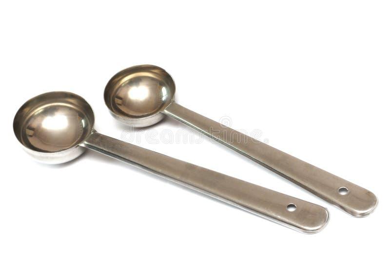 Scoops de mesure de cuillère d'huile de thé de café de sucre d'acier inoxydable images libres de droits