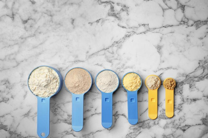 Scoops with different types of flour royalty free stock image