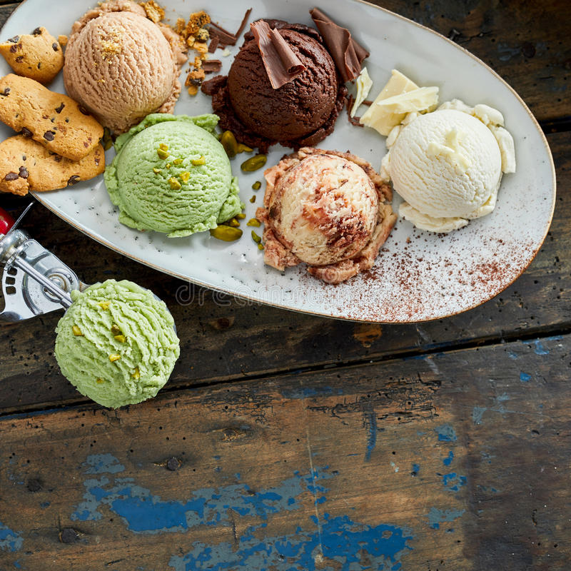 Scoops of Ice Cream on Platter with Garnishes royalty free stock photography