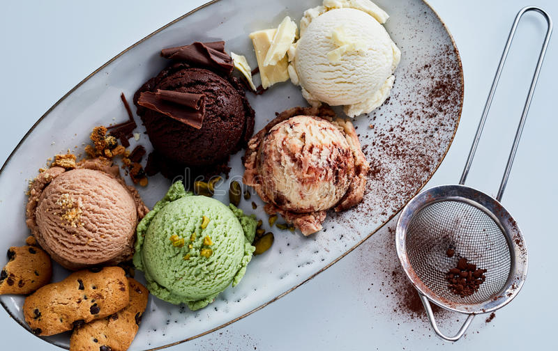 Scoops of Ice Cream on Platter with Garnishes royalty free stock photo