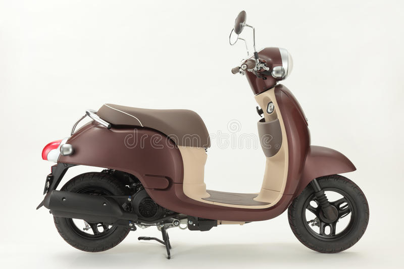 Scooter. Brown Scooter with white background stock image