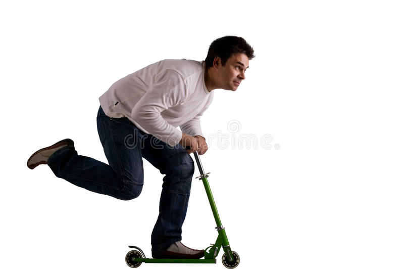 Scooter. Big man leaning forward and pushing the scooter with one foot on a white background stock images
