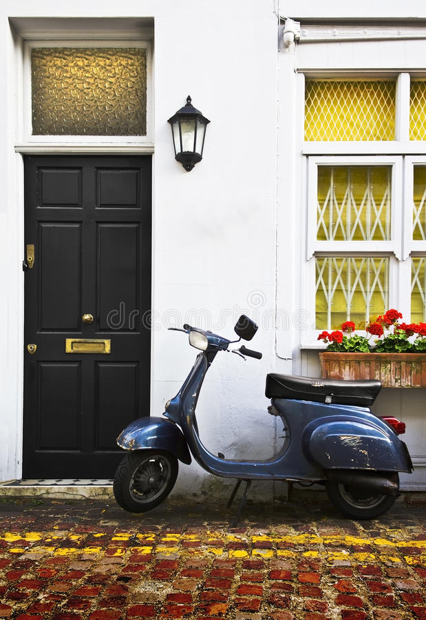 Scooter in London Mews. Scooter parking front of a typical apartment building in West London stock image