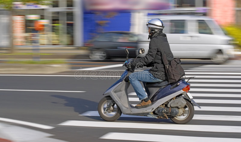 Scooter in motion stock image