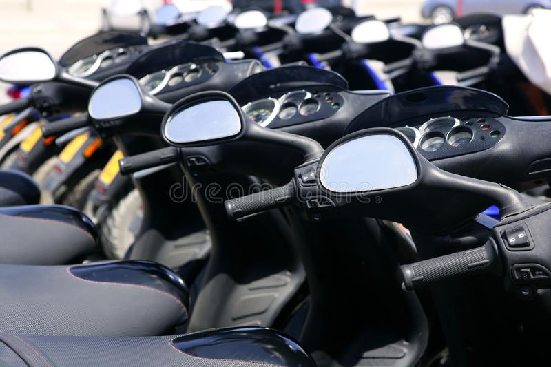 Scooter Motorbikes In A Row With Perspective Royalty Free Stock Image