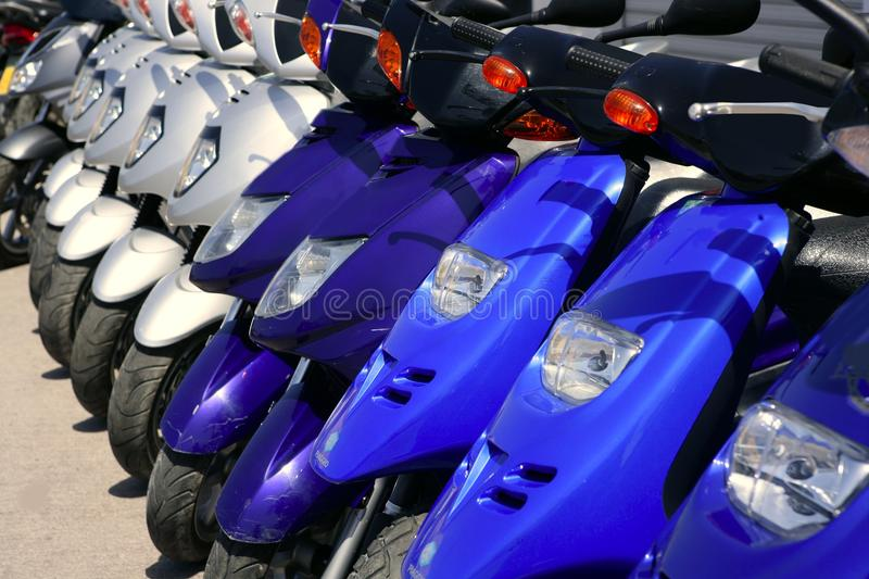 Download Scooter Motorbikes In A Row With Perspective Stock Image - Image: 9912639