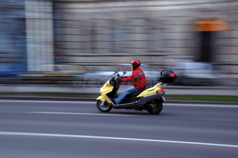 Scooter move stock images