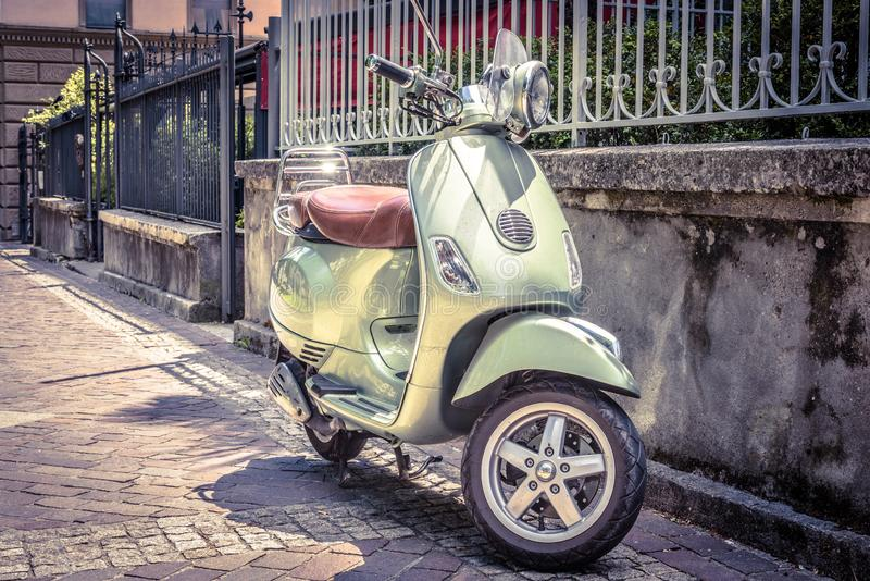 Scooter parked on an old street, Rome, Italy. Scooter parked on an old street. Scooter or motorbike is one of the most popular transport in Europe. Vintage style stock image