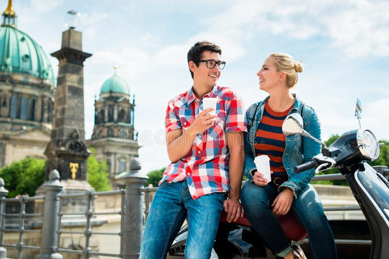 Scooter riding tourists drinking coffee in Berlin stock image