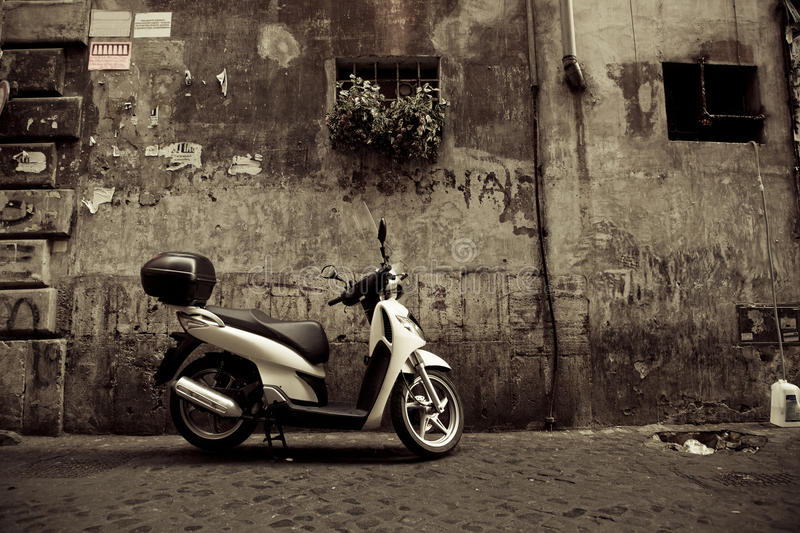 Scooter in Rome. White scooter in Rome street - sepia toned royalty free stock photo