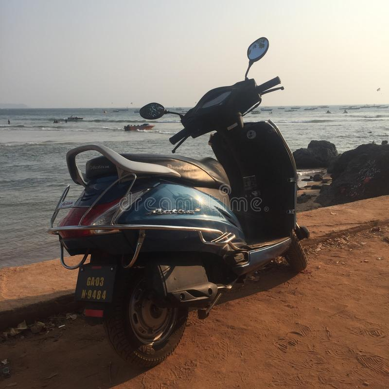 Scooter in Goa, Baga beach. Scooter standing on Baga beach of North Goa, India. January 2018 royalty free stock images