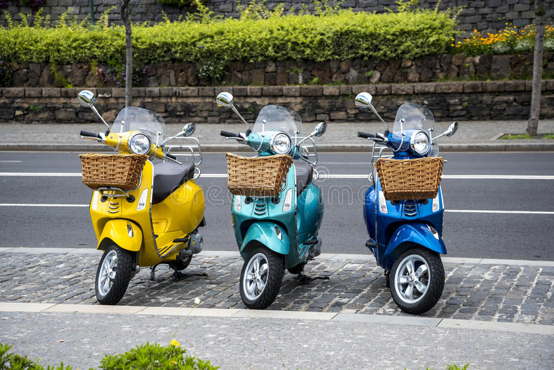 Scooters are a popular mode of transport in Funchal on the island of Madeira Portugal. These scooters buzz around all over the city, but the steep streets can royalty free stock photo