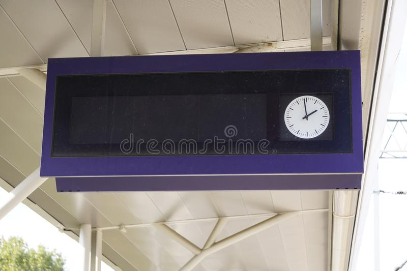 Scoreboard at the station with a clock for the schedule, track and platform, as well as the departure time. waiting for the. Scoreboard at station with a clock royalty free stock image