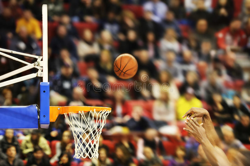 Scoring the winning points at a basketball game. Motion blur royalty free stock photo