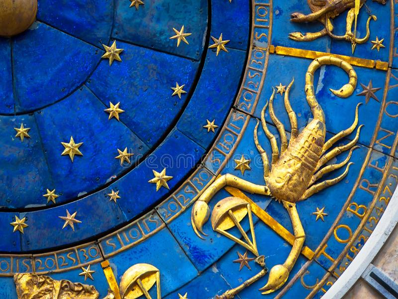 Scorpio astrological sign on ancient clock. Detail of Zodiac wheel with scorpion stock photography