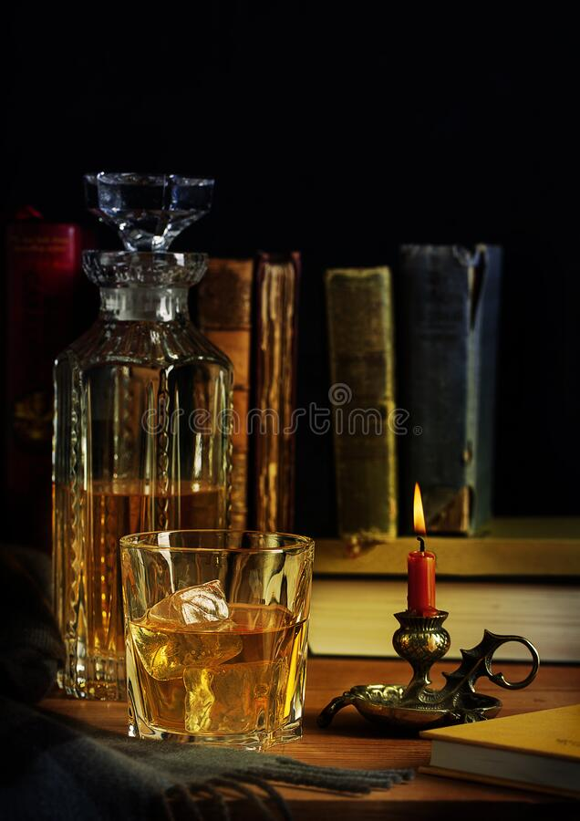 Free Scotch Whisky Ice With Burning Candle Royalty Free Stock Photos - 184356288