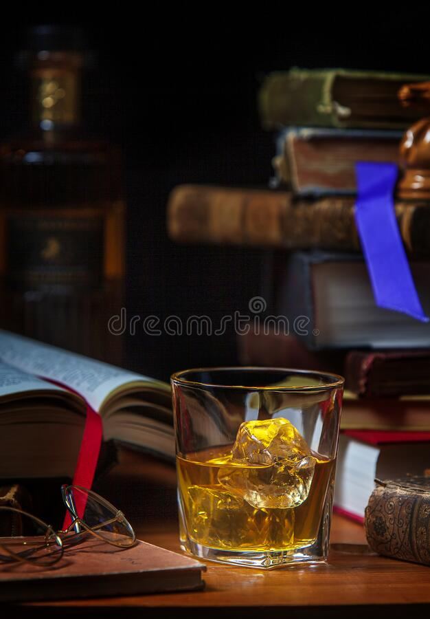 Free Scotch Whisky With Ice And Old Books Stock Image - 184266261