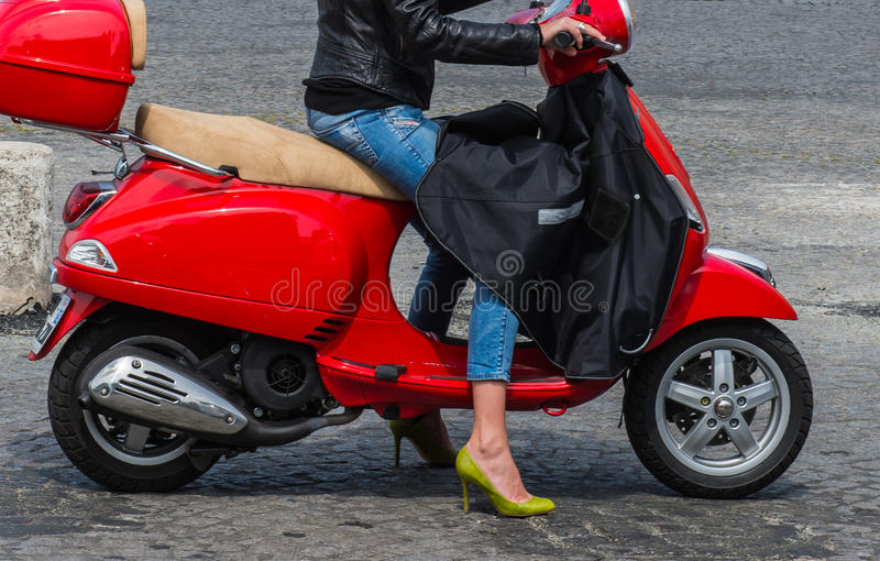 Scoter And Woman Royalty Free Stock Image
