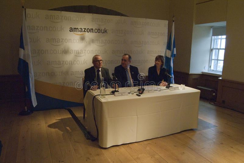 Scotland Amazon Deal. UK SCOTLAND Edinburgh --13 Jan 2011 -- The Chief Executive of Scottish Enterprise Lena Wilson right, First Minister Alex Salmond centre and royalty free stock images