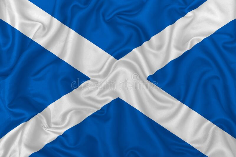 Scotland country flag. On wavy silk textile fabric background royalty free stock image