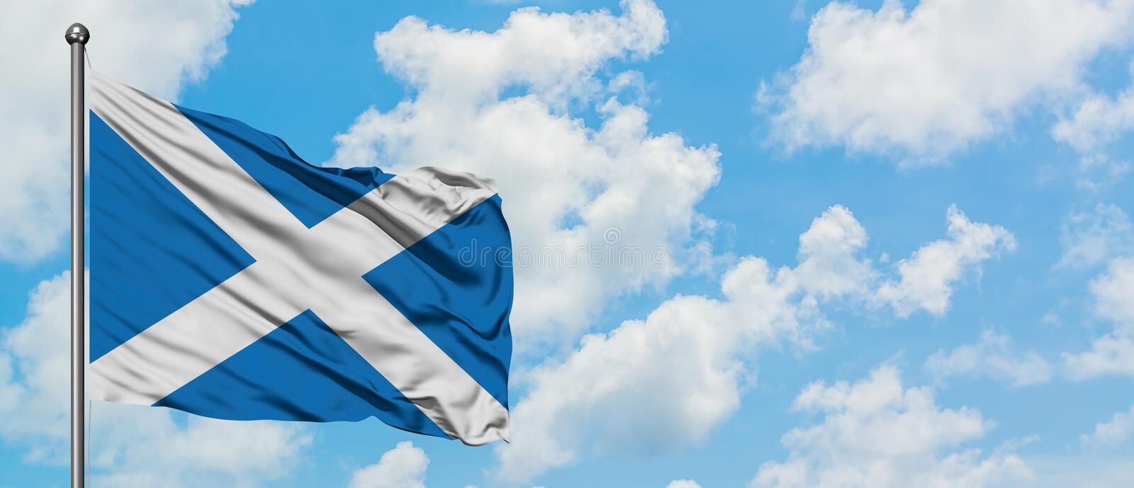Scotland flag waving in the wind against white cloudy blue sky. Diplomacy concept, international relations.  royalty free stock image