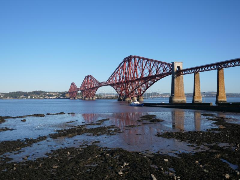 Scotland Forth Road Railway Bridge. This landscape includes the Forth bridge in Scotland known for its over-engineered designed that was meant to provide stock photography