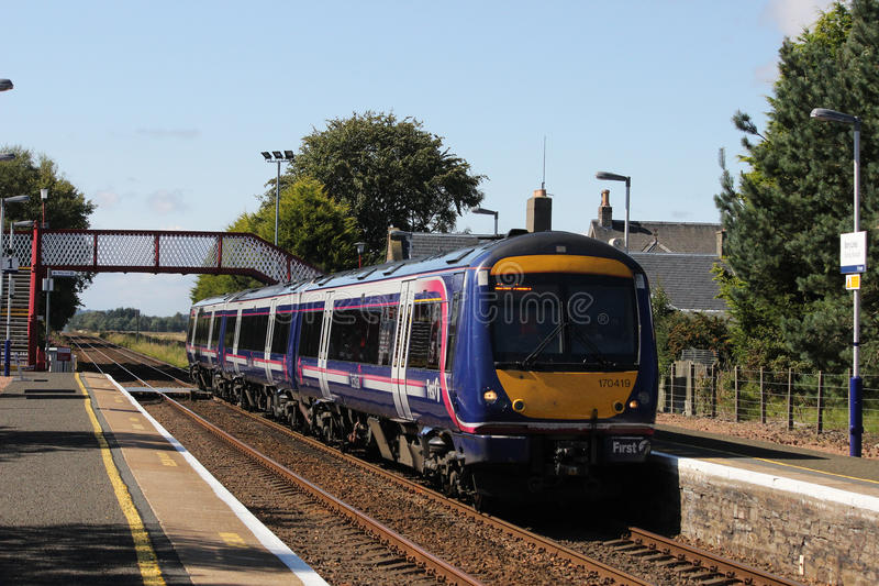 Scotrail dmu train passing Barry Links station. Class 170 diesel multiple unit train in Scotrail livery passing through Barry Links station with a passenger stock photos
