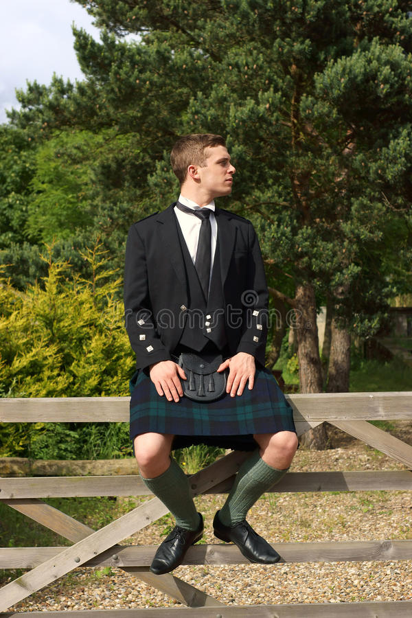 Scotsman in de volledige slijtage van de kledingskilt stock foto's