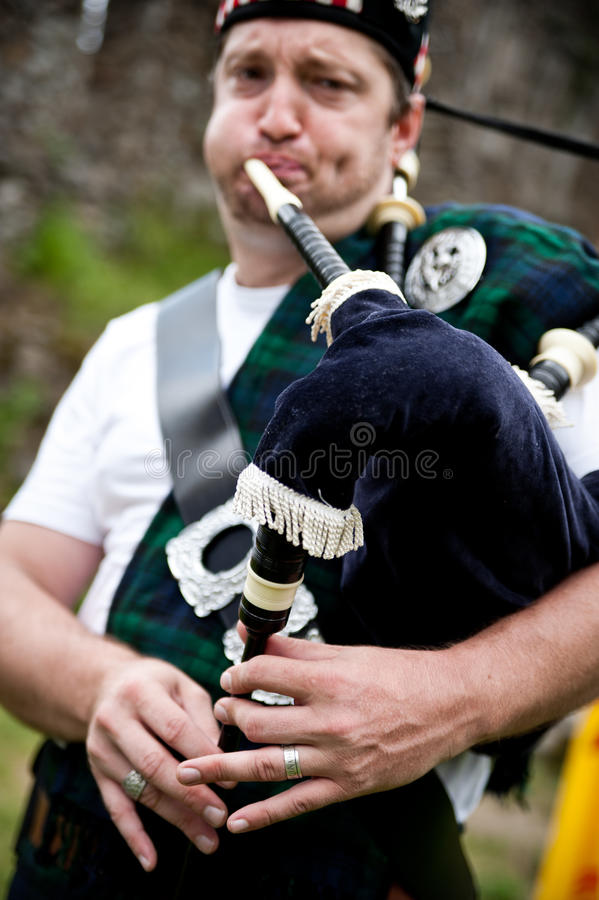 Scotsman playing Bagpipe. Scotsman playing outdoor his Bagpipe stock photos