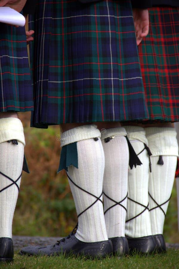 Scotsmen in kilten stock afbeeldingen