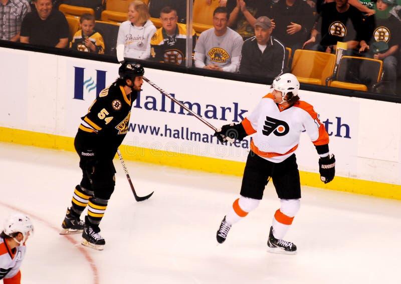 Scott Hartnell Philadephia Flyers. Flyers forward Scott Hartnell and Boston defenseman Adam McQauid exchange words royalty free stock photo