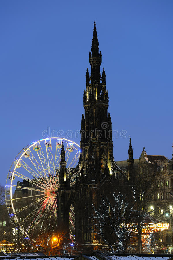 Scott Monument and big Ferris Wheel, Edinburgh royalty free stock images