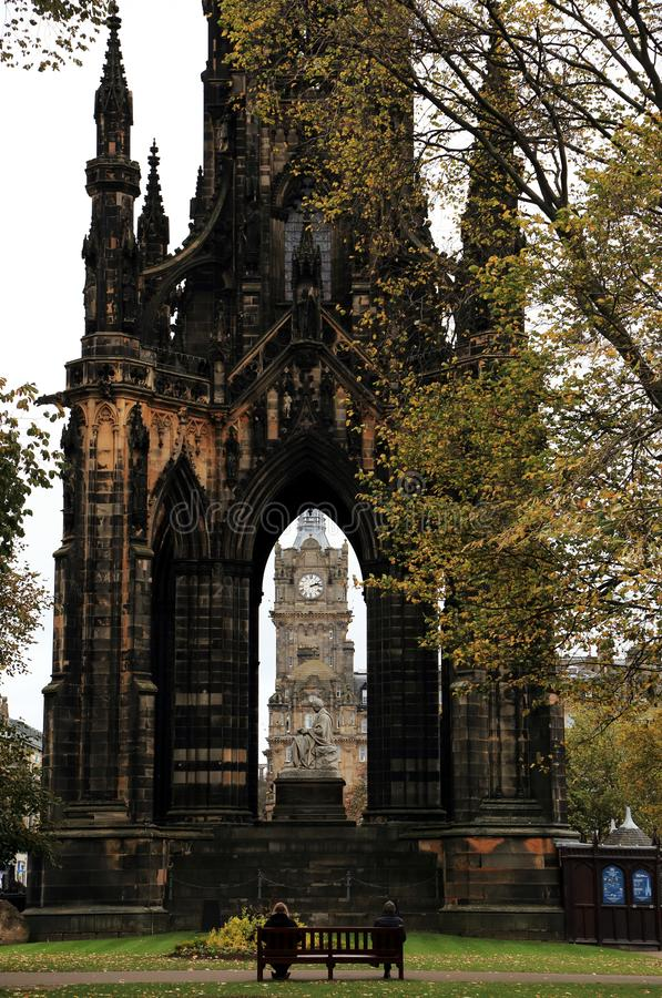 Scott Monument on Edinburgh`s Princess Street, a Victorian Gothic monument to Scottish author Sir Walter Scott. With clocktower at the center and bench with two stock photo