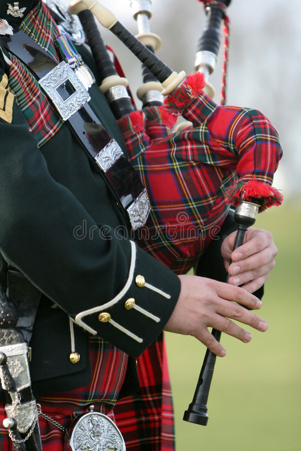 Scottish Bag Piper. Wonderful Traditional Costume of the Scottish Bag Piper royalty free stock photography