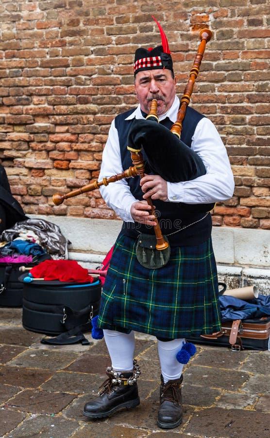 Scottish Bagpiper royalty free stock image