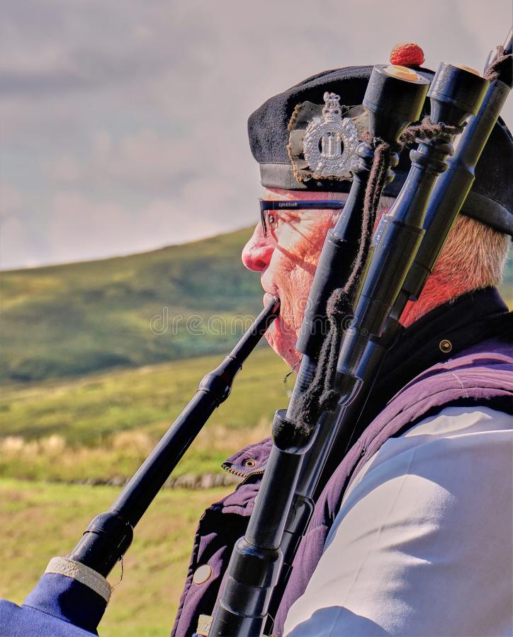 Scottish Bagpiper & Highlands - Close Up royalty free stock images