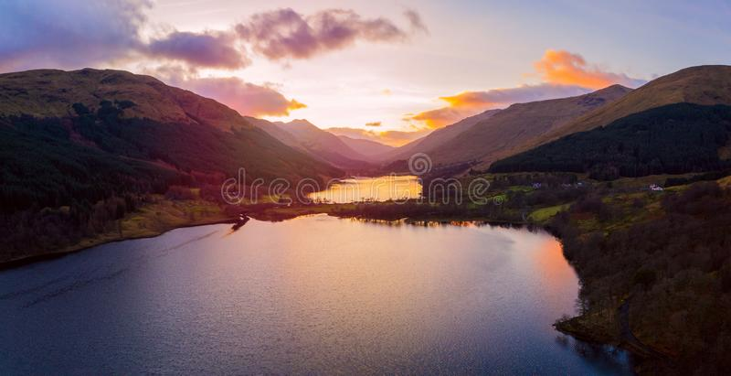 Scottish beautiful colorful sunset landscape with Loch Voil, mountains and forest at Loch Lomond & The Trossachs National Park. Scottish beautiful colourful stock photography