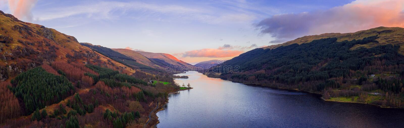 Scottish beautiful colorful sunset landscape with Loch Voil, mountains and forest at Loch Lomond & The Trossachs National Park stock images