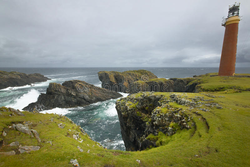 Scottish coastline landscape with lighthouse. of Lewis. Sco royalty free stock images
