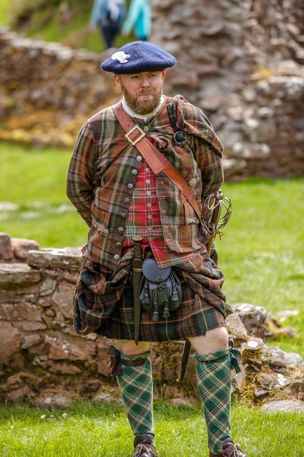 Scottish Highlander historical review. Urquhart Castle, United Kingdom - May 24, 2015: Scottish Highlander wearing kilt during a historical review at Urquhart