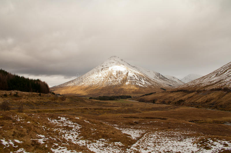 Scottish Highlands in late winter. A view towards Ben Dorain in the Scottish Highlands capped with snow in late winter stock photo