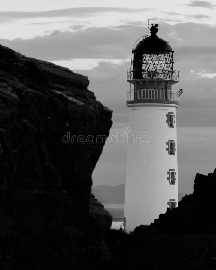 Scottish lighthouse next to cliff stock images