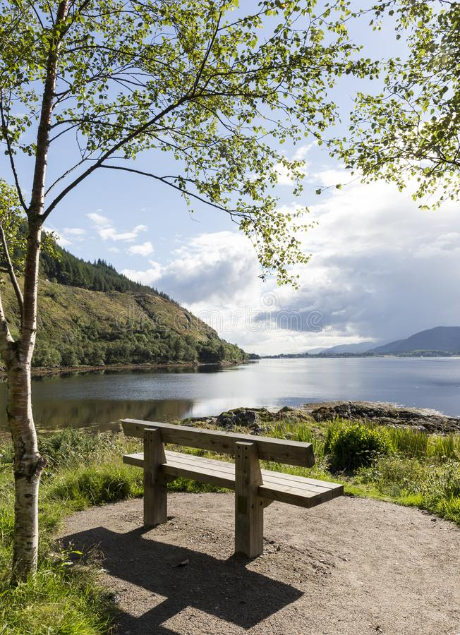Scottish Loch with bench. Romantic setting next a scottish loch with bench stock images