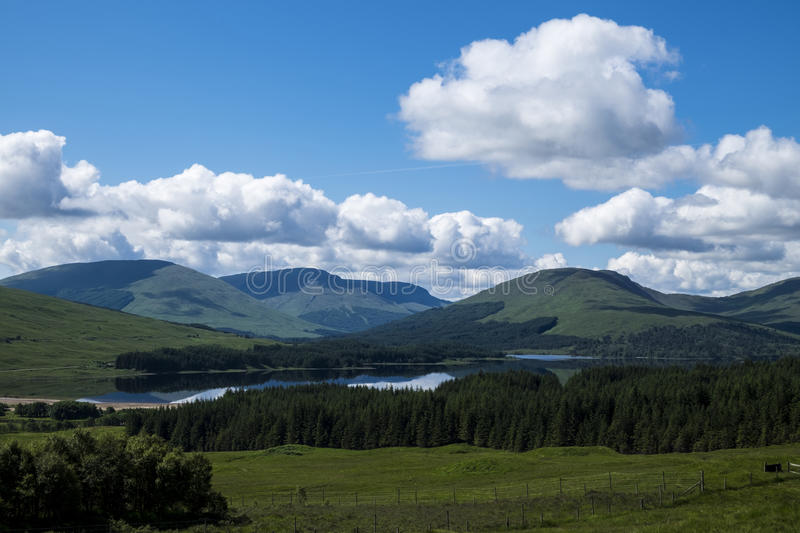 Scottish loch, hills and glens. Beautiful iconic Scottish landscape view with loch, hills and glens royalty free stock photo